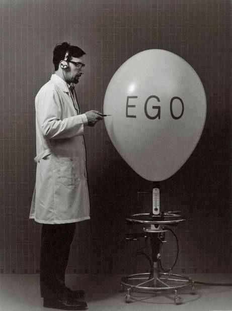 man popping an ego balloon