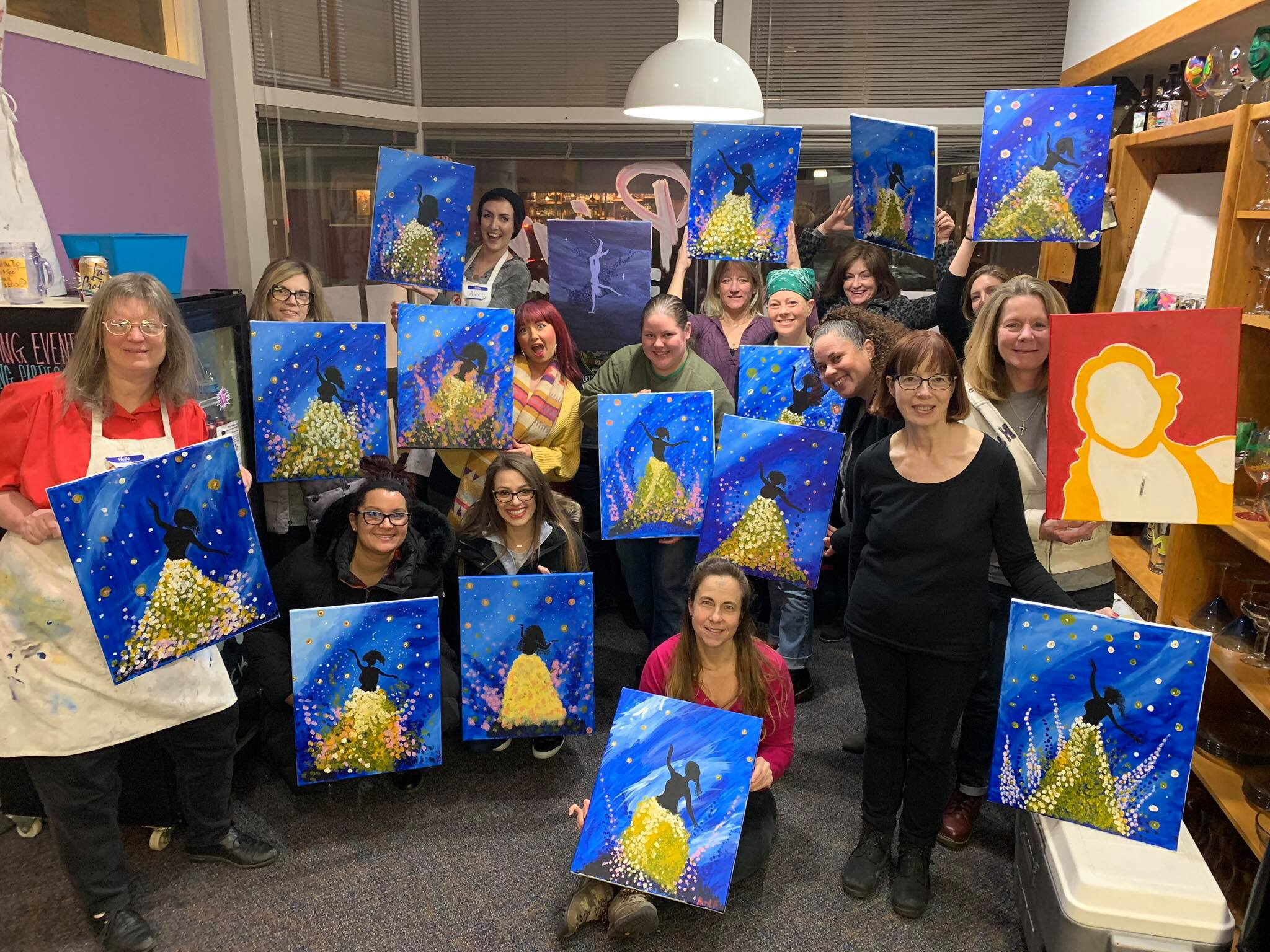 women holding paintings they just created